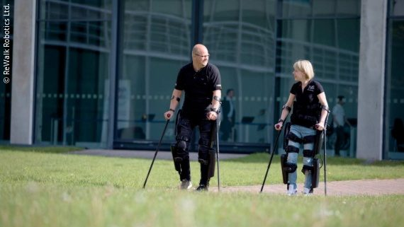 Photo: Two exoskeleton users during a