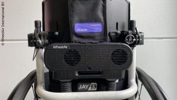 Photo: a wheelchair with an attached WheelAir; Copyright: WheelAir International BV