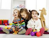 Photo: Three children with toys