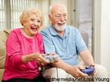 Photo: Old woman and man playing video games