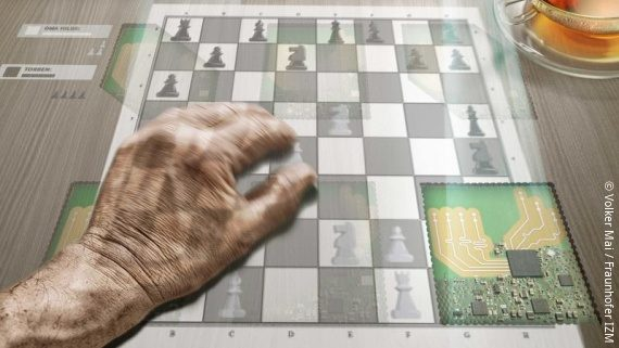 Photo: A chessboard projected onto a table surface; this technology is intended to address dementia patients; Copyright: Volker Mai / Fraunhofer IZM